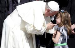 Pope Francis talks with Elizabeth 'Lizzy' Myers, a 5-year-old girl from Ohio, U.S. who suffers from a genetic disease known as Usher syndrome, which leads to blindness and hearing loss at the end of the weekly audience in Saint Peter's Square at the Vatican April 6, 2016.  REUTERS/Alessandro Bianchi