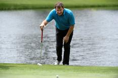 Apr 6, 2016; Augusta, GA, USA; Nick Faldo line up a putt on the 4th green during the Par 3 Contest prior to the 2016 The Masters golf tournament at Augusta National Golf Club. Mandatory Credit: Michael Madrid-USA TODAY Sports