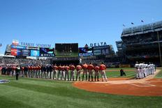 Apr 5, 2016; Bronx, NY, USA; New York Yankees and the Houston Astros during the singing of the National Anthem before the game at Yankee Stadium. Mandatory Credit: Anthony Gruppuso-USA TODAY Sports