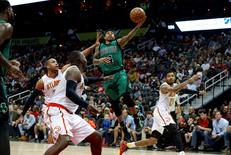 Apr 9, 2016; Atlanta, GA, USA; Boston Celtics guard Isaiah Thomas (4) attempts a shot against Atlanta Hawks center Al Horford (15), forward Paul Millsap (4), and forward Kent Bazemore (24) in the fourth quarter of their game at Philips Arena. The Hawks won 118-107. Mandatory Credit: Jason Getz-USA TODAY Sports