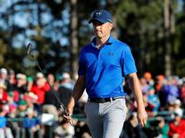 Apr 8, 2016; Augusta, GA, USA; Jordan Spieth makes par on the 18th green during the second round of the 2016 The Masters golf tournament at Augusta National Golf Club. Mandatory Credit: Rob Schumacher-USA TODAY Sports - RTX295WT