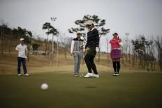 A group of visitors plays golf at a golf course in Ansung, South Korea, April 6, 2016.  REUTERS/Kim Hong-Ji