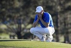 Apr 10, 2016; Augusta, GA, USA; Jordan Spieth reacts as he waits to putt on the 18th green during the final round of the 2016 The Masters golf tournament at Augusta National Golf Club. Mandatory Credit: Michael Madrid-USA TODAY Sports -