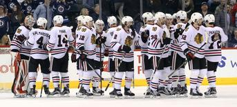 Mar 18, 2016; Winnipeg, Manitoba, CAN; Chicago Blackhawks celebrate their win over the Winnipeg Jets  after the third period at MTS Centre. Chicago Blackhawks win 4-0. Mandatory Credit: Bruce Fedyck-USA TODAY Sports