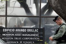 Police officers stand guard next to a company list showing the Mossack Fonseca law firm outside their office in Panama City April 12, 2016. REUTERS/Carlos Jasso