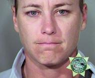 Retired U.S. woman's soccer star Abby Wambach is seen in an undated booking photo released by the Multnomah County Sheriff's Office in Portland, Oregon. Wambach was arrested in Oregon on charges of driving under the influence of alcohol, police said Sunday.  REUTERS/Multnomah County Sheriff's Office/Handout via Reuters