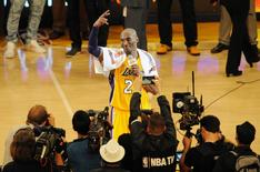 April 13, 2016; Los Angeles, CA, USA; Los Angeles Lakers  forward Kobe Bryant (24) speaks to the crowd following the 101-96 victory against Utah Jazz during the second half at Staples Center. Gary A. Vasquez-USA TODAY Sports