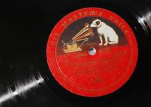 """A vinyl record bearing the logo of label """"His Master's Voice"""" are pictured at the Classic-Choice dealership of rare previously owned classical LP's in London January 15, 2013.  REUTERS/Luke MacGregor"""