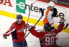 Apr 14, 2016; Washington, DC, USA; Washington Capitals center Jay Beagle (83) celebrates with Capitals center Marcus Johansson (90) after scoring a goal against the Philadelphia Flyers in the third period in game one of the first round of the 2016 Stanley Cup Playoffs at Verizon Center.  Geoff Burke-USA TODAY Sports