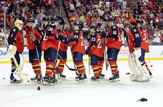 Apr 15, 2016; Sunrise, FL, USA;The Florida Panthers line up to congratulate goalie Roberto Luongo (1) after defeating the New York Islanders 3-1 in game two of the first round of the 2016 Stanley Cup Playoffs at BB&T Center. Mandatory Credit: Robert Duyos-USA TODAY Sports