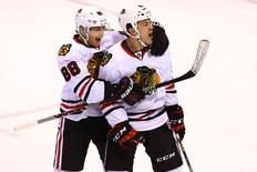 Apr 15, 2016; St. Louis, MO, USA; Chicago Blackhawks center Andrew Shaw (65) celebrates with Patrick Kane (88) after scoring a goal against St. Louis Blues goalie Brian Elliott (not pictured) during the third period in game two of the first round of the 2016 Stanley Cup Playoffs at Scottrade Center. The Blackhawks won the game 3-2. Mandatory Credit: Billy Hurst-USA TODAY Sports