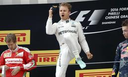 Formula One - Chinese F1 Grand Prix - Shanghai, China - 17/4/16 - Mercedes Formula One driver Nico Rosberg of Germany (C), Red Bull Formula One driver Daniil Kvyat of Russia (R) and Ferrari Formula One driver Sebastian Vettel of Germany after the Chinese Grand Prix. REUTERS/Aly Song