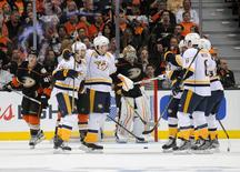 April 17, 2016; Anaheim, CA, USA; Nashville Predators celebrate the goal scored by center Craig Smith (15) against Anaheim Ducks during the second period in game two of the first round of the 2016 Stanley Cup Playoffs at Honda Center.  Gary A. Vasquez-USA TODAY Sports