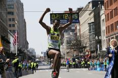 Lemi Berhanu Hayle of Ethiopia crosses the finish line to win the men?s division of the 120th running of the Boston Marathon in Boston, Massachusetts April 18, 2016.  REUTERS/Brian Snyder -