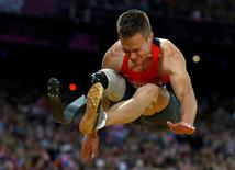 Germany's Markus Rehm wins gold in the men's long Jump F42/44 classification final during the London 2012 Paralympic Games at the Olympic Stadium August 31, 2012.   REUTERS/Eddie Keogh