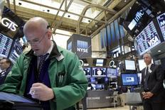 Traders work on the floor of the New York Stock Exchange (NYSE) April 15, 2016. REUTERS/Brendan McDermid