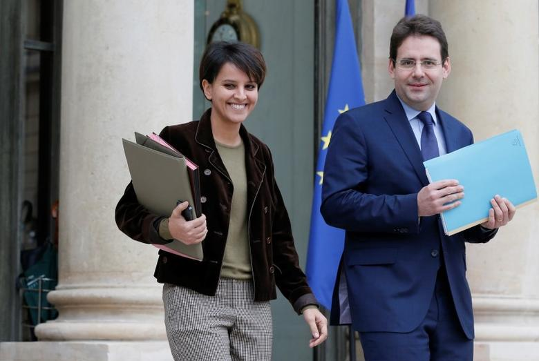 French Education and Research minister Najat Vallaud-Belkacem (L) and junior Minister for Foreign Trade Matthias Fekl, leave after the weekly cabinet meeting at the Elysee Palace in Paris December 22, 2014. REUTERS/Gonzalo Fuentes