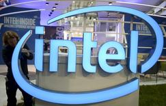 A worker arranges an Intel logo at the CeBIT trade fair, the world's biggest computer and software fair, in Hannover in this March 13, 2016, file photo. REUTERS/Nigel Treblin/Files