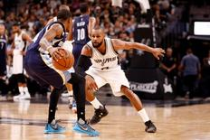 Memphis Grizzlies point guard Xavier Munford (14, front) dribbles the ball as San Antonio Spurs point guard Patty Mills (8, behind) defends in game two of the first round of the NBA Playoffs at AT&T Center. Mandatory Credit: Soobum Im-USA TODAY Sports