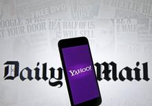 Smartphone with Yahoo logo is seen in front of a displayed Daily Mail logo in this illustration taken April 11, 2016.  REUTERS/Dado Ruvic/Illustration