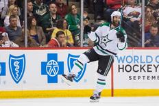 Dallas Stars forward Patrick Eaves (18) celebrates after scoring a goal in the second period against the Minnesota Wild in game four of the first round of the 2016 Stanley Cup Playoffs at Xcel Energy Center. Mandatory Credit: Brad Rempel-USA TODAY Sports