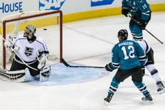 San Jose Sharks left wing Patrick Marleau (12) shoots and scores against Los Angeles Kings goalie Jonathan Quick (32) in the third period of game four of the first round of the 2016 Stanley Cup Playoffs at SAP Center at San Jose. The Sharks won 3-2. Mandatory Credit: John Hefti-USA TODAY Sports