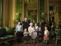 Britain's Queen Elizabeth II poses with her five great-grandchildren and her two youngest grandchildren in the Green Drawing Room, part of Windsor Castle's semi-State apartments. The children are: James, Viscount Severn (left), 8, and Lady Louise (second left), 12, the children of The Earl and Countess of Wessex;  Mia Tindall (holding The Queen's handbag), the two year-old-daughter of Zara and Mike Tindall; Savannah (third right), 5, and Isla Phillips (right), 3, daughters of The Queen's eldest grandson Peter Phillips and his wife Autumn; Prince George (second right), 2, and in The Queen's arms and in the tradition of Royal portraiture, the youngest great-grandchild, Princess Charlotte (11 months), children of The Duke and Duchess of Cambridge, in this official photograph, released by Buckingham Palace to mark her 90th birthday April 20, 2016 Credit must read: c2016 Annie Leibovitz/Handout via REUTERS