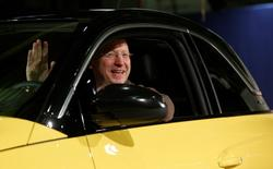 General Motors Vice Chairman, interim President of GM Europe and Chairman of the Opel Supervisory Board Steve Girsky waves as he sits inside an Opel Adam car during the start of the car production in Eisenach January 10, 2013. REUTERS/Lisi Niesner