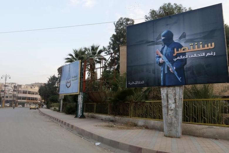 Islamic State billboards are seen along a street in Raqqa, eastern Syria, which is controlled by the Islamic State, October 29, 2014.  REUTERS/Nour Fourat