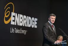 Al Monaco, President and CEO, Enbridge, stands when introduced during the Enbridge Income Fund annual general meeting for shareholders in Toronto May 6, 2015.  REUTERS/Peter Power