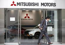 A man walks out from Mitsubishi Motors Corp's showroom at its headquarters in Tokyo, Japan, April 21, 2016.   REUTERS/Toru Hanai