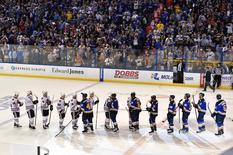 St. Louis Blues and Chicago Blackhawks teammates line up to shake hands after St. Louis Blues defeat the Chicago Blackhawks 3-2 in game seven of the first round of the 2016 Stanley Cup Playoffs at Scottrade Center. Mandatory Credit: Jasen Vinlove-USA TODAY Sports