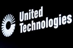 The ticker symbol for United Technologies is displayed at the post where it is traded on the floor of the New York Stock Exchange (NYSE) February 23, 2016. REUTERS/Brendan McDermid