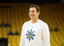 Golden State Warriors assistant coach Luke Walton smiles during warm ups before game five against the Houston Rockets of the first round of the NBA Playoffs at Oracle Arena. Mandatory Credit: Kelley L Cox-USA TODAY Sports