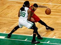 Atlanta Hawks forward Mike Scott (right) dribbles the ball against Boston Celtics forward Jae Crowder (99) during the first half in game six of the first round of the NBA Playoffs at TD Garden. Mandatory Credit: Mark L. Baer-USA TODAY Sports