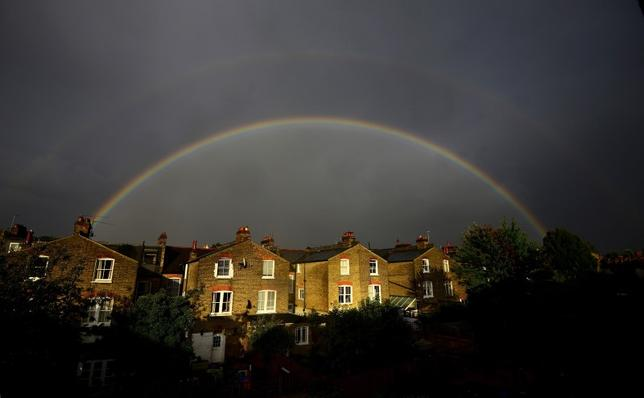 A double rainbow is seen above a row of terrace houses in Clapham, south London, Britain in this file photograph dated September 1, 2015.  REUTERS/Dylan Martinez/files