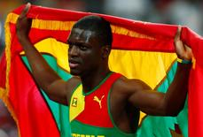 Kirani James of Grenada holds his national flag after placing third in the men's 400 metres final at the IAAF World Championships at the National Stadium in Beijing, China August 26, 2015.   REUTERS/David Gray
