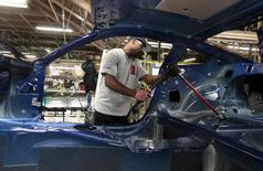 A Ford Motor assembly worker works on the frame of a 2015 Ford Mustang vehicle at the Ford Motor Flat Rock Assembly Plant in Flat Rock, Michigan, August 20, 2015.  REUTERS/Rebecca Cook