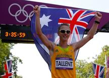 Australia's Jared Tallent celebrates with his national flag after winning silver in the men's 50km race walk during the London 2012 Olympic Games at The Mall August 11, 2012.  REUTERS/Laszlo Balogh