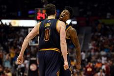 May 8, 2016; Atlanta, GA, USA; Cleveland Cavaliers forward Kevin Love (0) and guard Iman Shumpert (4) reacts after a basket against the Atlanta Hawks during the second half in game four of the second round of the NBA Playoffs at Philips Arena. The Cavaliers defeated the Hawks 100-99. Mandatory Credit: Dale Zanine-USA TODAY Sports