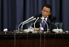 Japan's Finance Minister Taro Aso attends a news conference at the Finance Ministry in Tokyo December 24, 2015. REUTERS/Issei Kato