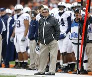 Penn State University head coach Joe Paterno looks toward the scoreboard during his team's game against the University of Illinois in their NCAA football game in Champaign, Illinois, U.S. October 3, 2009.  REUTERS/Jeff Haynes/File Photo
