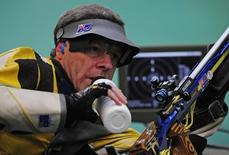 Warren Potent of Australia pauses during the men's 50m rifle prone final shooting competition at the Beijing 2008 Olympic Games August 15, 2008.     REUTERS/Desmond Boylan