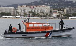 French Gendarmes on a boat patrol in the bay of Cannes to survey the coast and the boats few hours before the opening ceremony of the 69th Cannes Film Festival in Cannes, France, May 11, 2016. REUTERS/Regis Duvignau