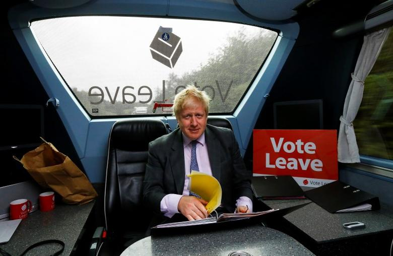 Former London Mayor Boris Johnson works in the back of the Vote Leave bus as it heads towards Exeter, in Britain May 11, 2016. REUTERS/Darren Staples