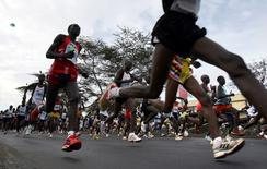 Runners compete at the start of the Nairobi marathon in Nairobi Kenya, October 29, 2006. REUTERS/Radu Sigheti/File Photo