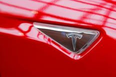 A Tesla logo on a Model S is photographed inside of a Tesla dealership in New York, U.S., April 29, 2016. REUTERS/Lucas Jackson/File Photo