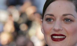 "Cast member Marion Cotillard poses on the red carpet as she arrives for the screening of the film ""Mal de pierres"" (From the Land of the Moon) in competition at the 69th Cannes Film Festival in Cannes, France, May 15, 2016.REUTERS/Regis Duvignau"