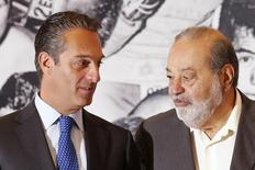 Mexican tycoon Carlos Slim Helu (R) speaks with his son and Chairman of the Board of Directors of Grupo Carso, Carlos Slim Domit, before receiving a recognition from WBC for his support for boxing via Telmex foundation at Soumaya museum, in Mexico City, Mexico, March 10, 2016. REUTERS/Edgard Garrido/File Photo