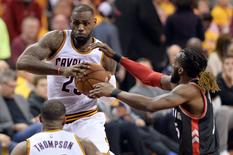 May 17, 2016; Cleveland, OH, USA; Cleveland Cavaliers forward LeBron James (23) drives against Toronto Raptors forward DeMarre Carroll (5) during the third quarter in game one of the Eastern conference finals of the NBA Playoffs at Quicken Loans Arena. The Cavs won 115-84. Mandatory Credit: Ken Blaze-USA TODAY Sports